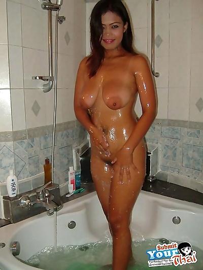 Busty thai girlfriend sucks..
