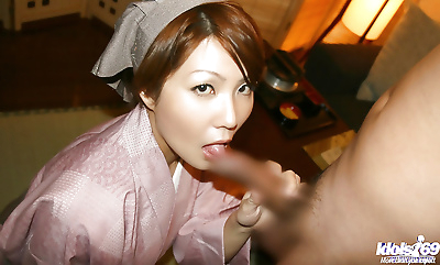 Naughty asian girl gives a..