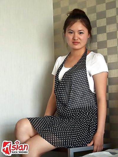 Asian lady undressing on..