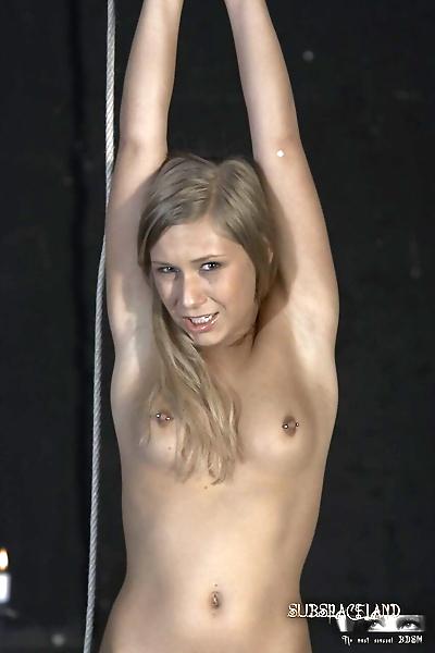 Helpless blonde girl secures..