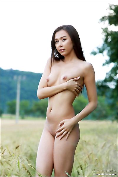 Naked Asian girl lies down..