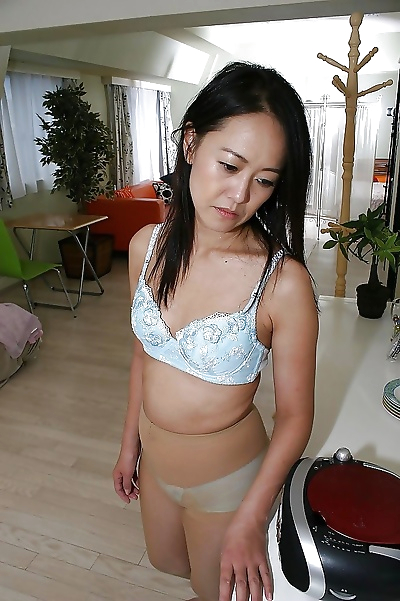 Asian gal in pantyhose Terumi Irie undressing and exposing her inviting cunt
