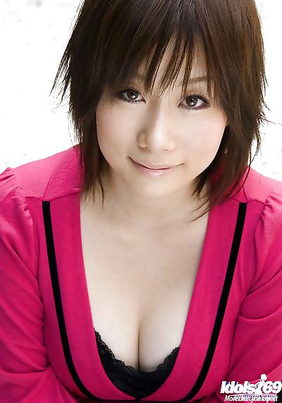 Asian coed Hanano Nono slowly uncovering her amazing big bosoms