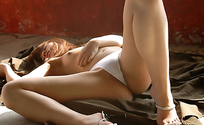 Cute Japanese girl gets naked while changing from a bikini to lingerie