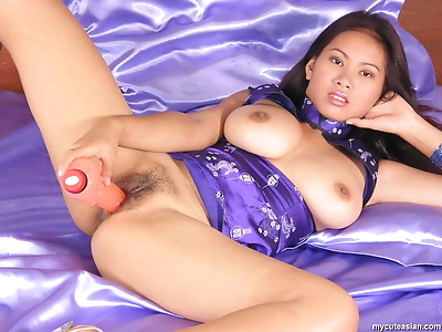 Big titted Thai girl takes a dildo to her trimmed snatch in heels