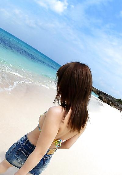 Japanese teen Chikaho Ito models non nude at the beach in a bikini