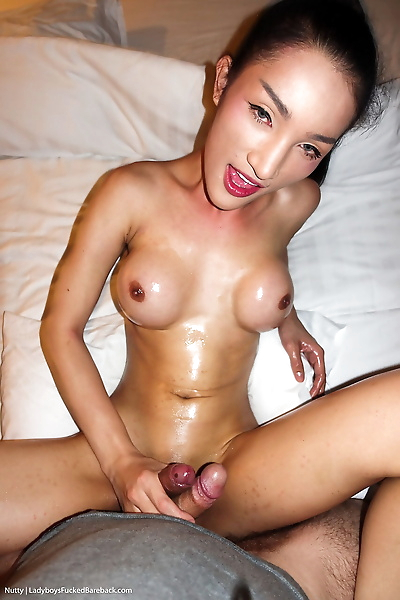 Skinny Asian tranny Nutty gets bare back banged POV style in high heels