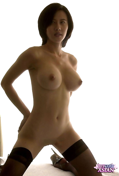 Big titted Asian amateur showcases her shaved vagina in stockings and heels