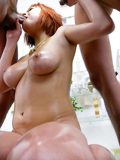 Red-haired Japanese with big natural tits Sara gets oiled and fucked by two