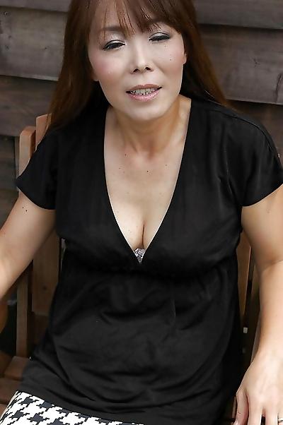 Frisky asian MILF Kayo Mukai undressing and spreading her legs outdoor