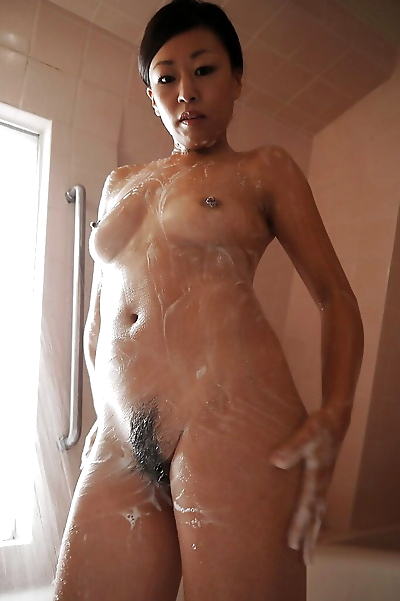 Asian babe Kayoko Ikehata is playing with her hairy vagina on cam